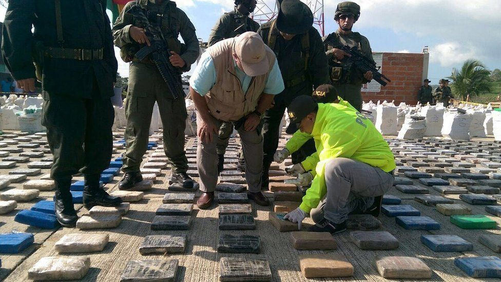 Colombian police inspect confiscated packages of cocaine in Turbo, Colombia, 15 May 2016