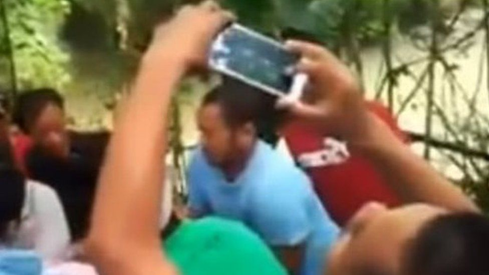 A screengrab from YouTube. Villagers baffled by the incident recorded the event on their phones
