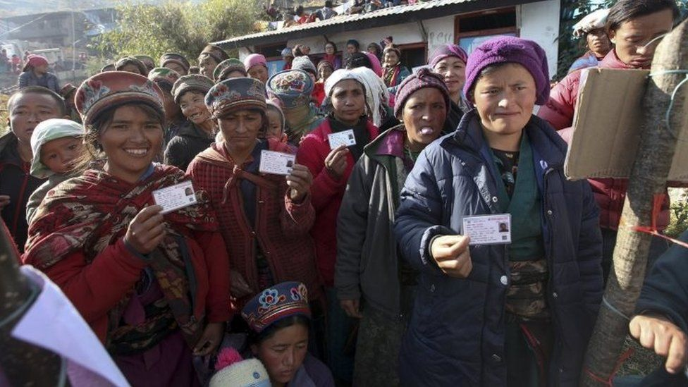 People show their voter ID cards before casting ballots in Rashuwa district, Nepal. Photo: 26 November 2017