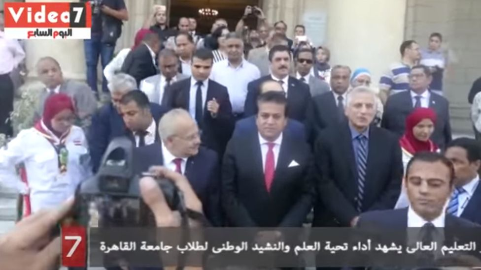 Egyptian Higher Education Minister Khaled Minister Abdel Ghaffar (centre) at a flag ceremony