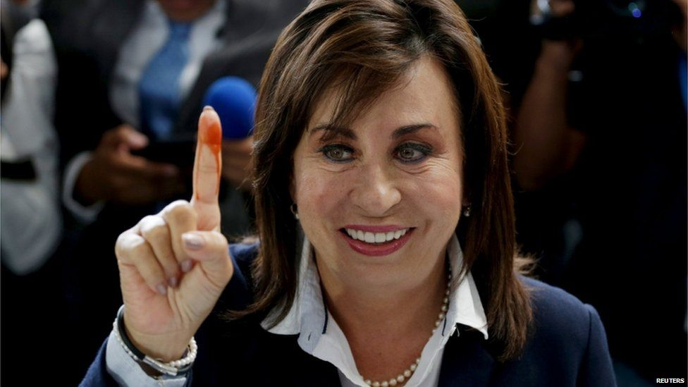Guatemalan presidential candidate Sandra Torres, from the centre-left National Unity of Hope (UNE) party, shows her ink-marked finger after casting her vote, at a polling station during general elections in Guatemala City, on 6 September 2015.