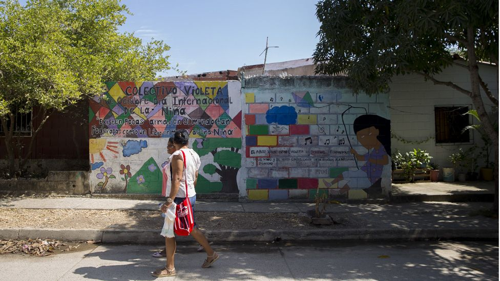 "Alneris Orozco Caupo and other women living in the City walk down ""Avenida Guerrera,"" or ""Avenue of the Woman Warrior"" in Turbaco"