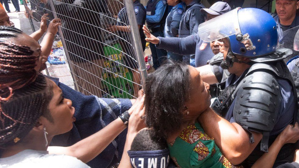 Police clash with foreign nationals staging a sit-in protest at Waldorf Arcade