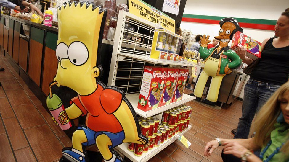 Representations of 'Bart Simpson' (L) and 'Apu' from the long-running television cartoon show 'The Simpsons' are on display at a 7-11 store at 345 W. 42nd Street, converted into a Kwik-E-Mart from the show to promote 'The Simpsons Movie' opening next month, July 2, 2007.