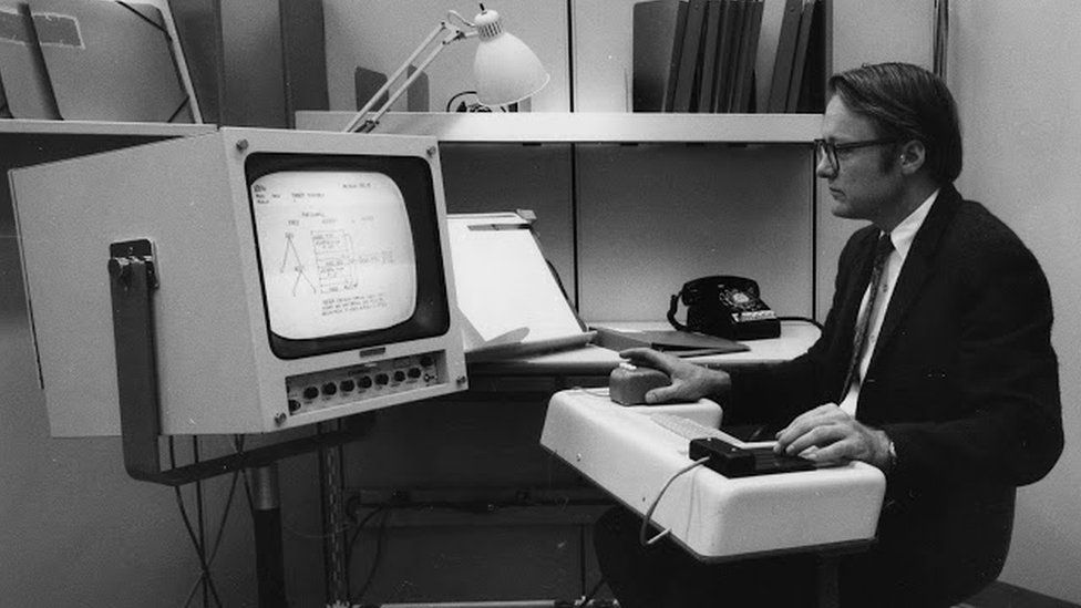 A young Bill English sits at an old 1960s computer terminal in this 1960s archive photo