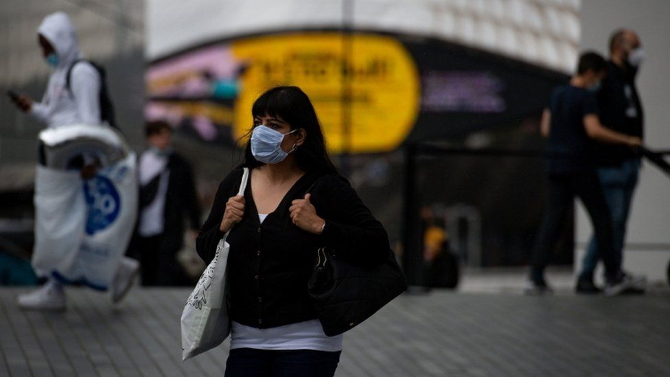 A woman wearing a mask in Birmingham city centre