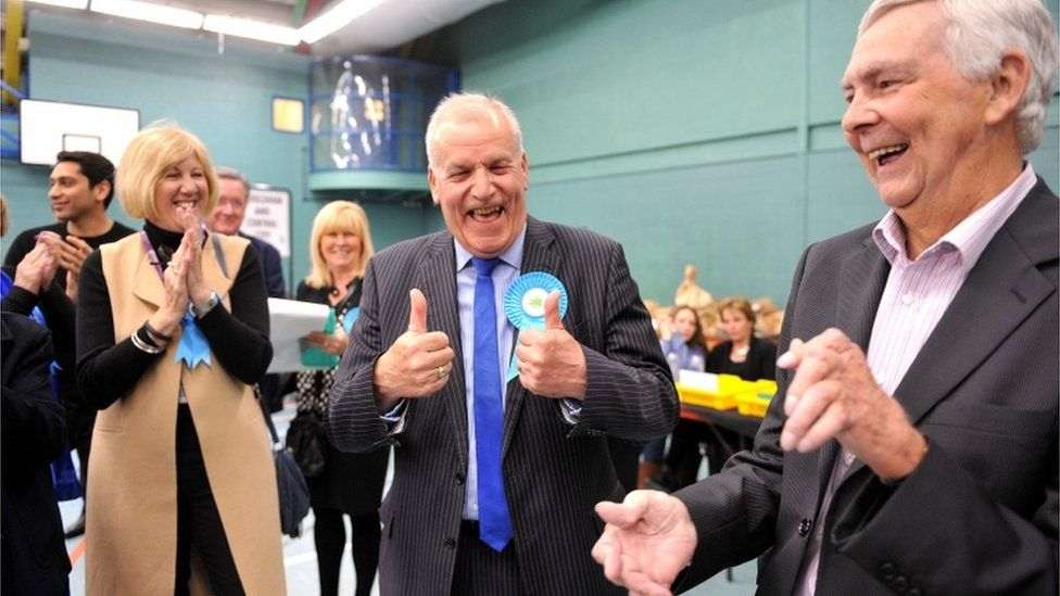Conservative candidate for Chelmsford Central, Dick Madden, celebrates with colleagues after retaining his seat in the Essex County Council local elections