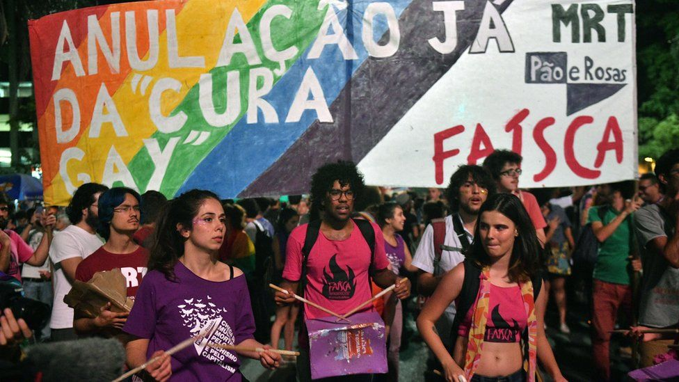 People protest against a Brazilian judge's decision to approve conversion therapy