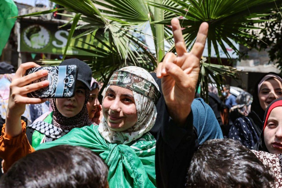 Palestinian supporters of Hamas celebrate the ceasefire between Hamas and Israel, in Khan Younis, in the southern Gaza Strip, on May 21, 2021.