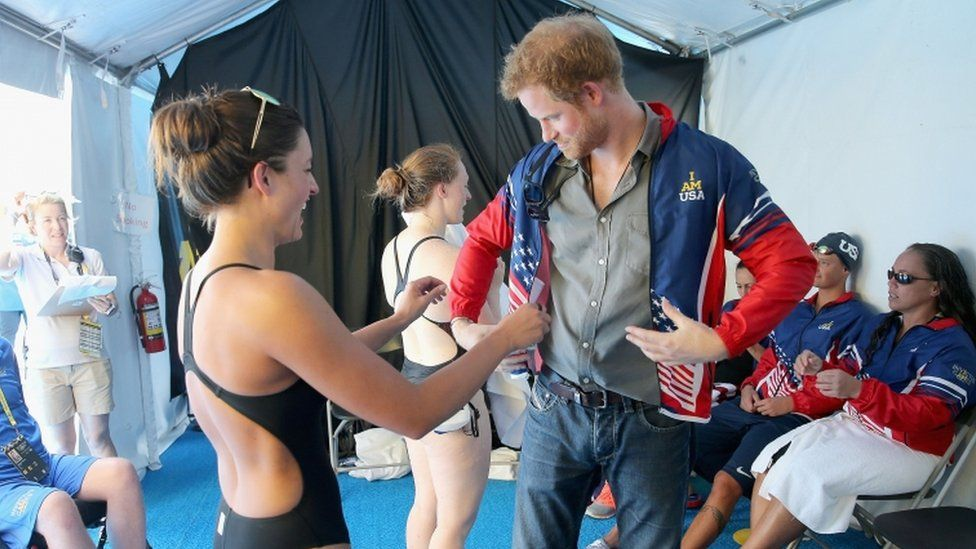 Prince Harry tries on Elizabeth Marks' jacket