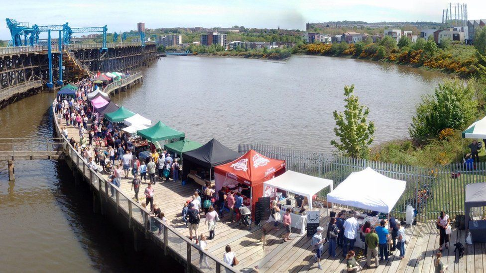 Stalls and customers line the bottom deck of Dunston Staiths for one of the monthly food markets