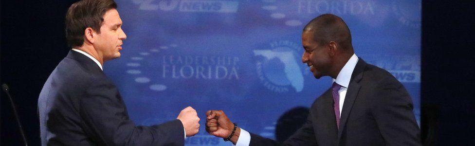 Republican Ron DeSantis and Democrat Andrew Gillum fist bump after a debate in Florida