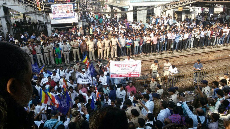 Thousands of protesters from India's low-caste Dalit community disrupted key transport services in Mumbai.