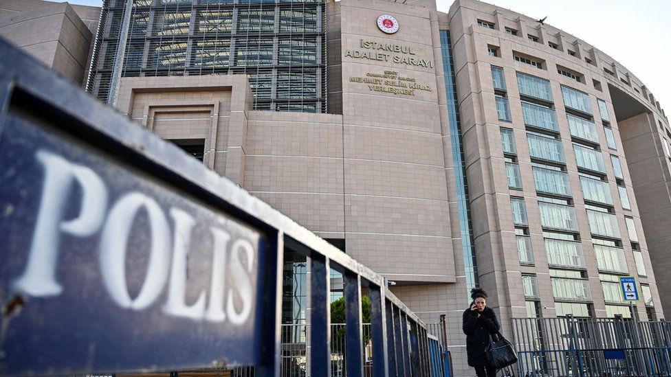 A woman walks in front of the courthouse in Istanbul on December 11, 2019 during the trial of Metin Topuz