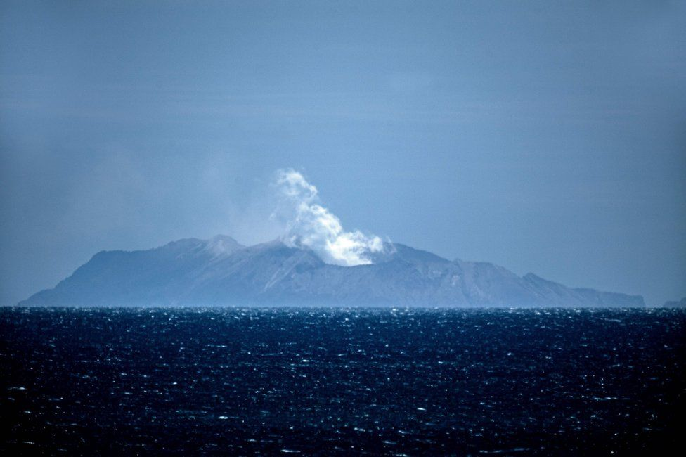 Steam rises from the White Island volcano