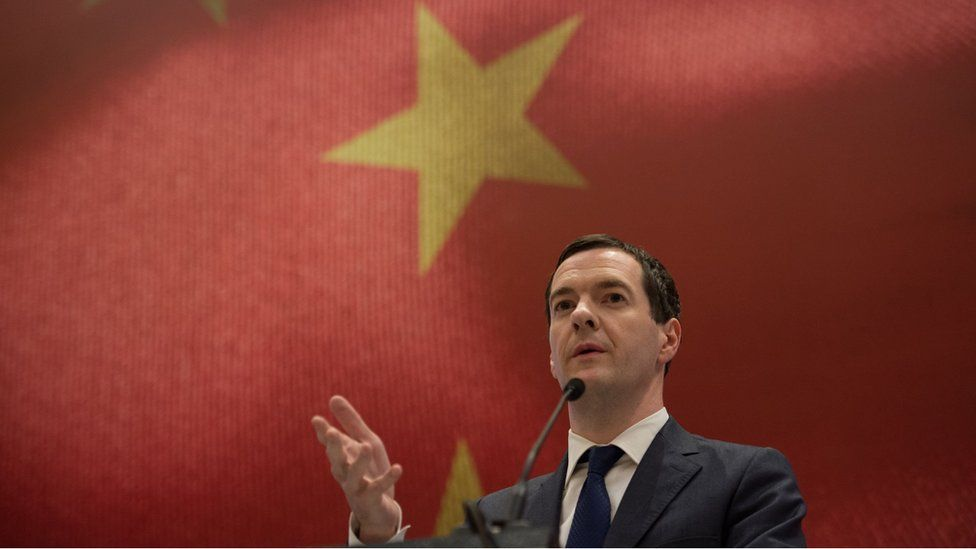 Chancellor George Osborne speaking during a meeting with Chinese investors in Chengdu, with a gigantic Chinese flag on a screen behind him. 24 September 2015.