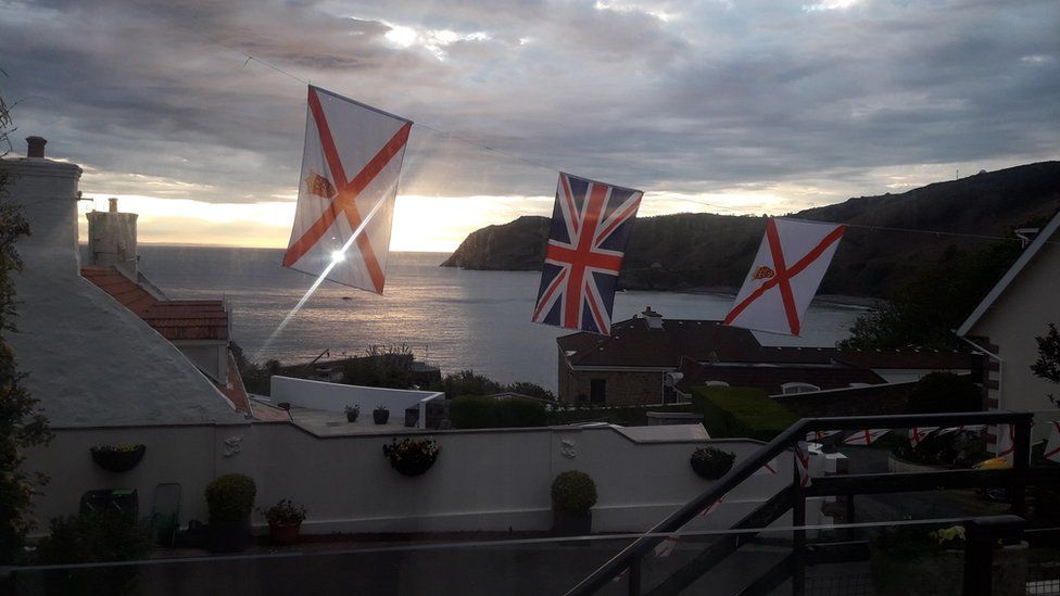 Jersey and Union flags hung
