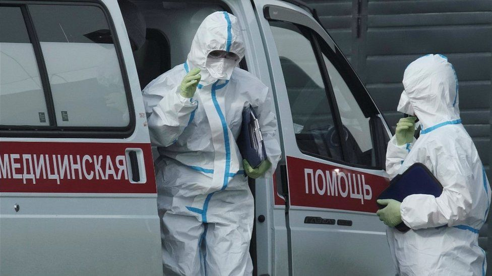 Specialist coronavirus medics outside a hospital in a Moscow suburb, 21 Apr 20