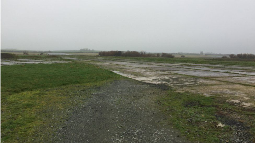Land next to Mona airfield