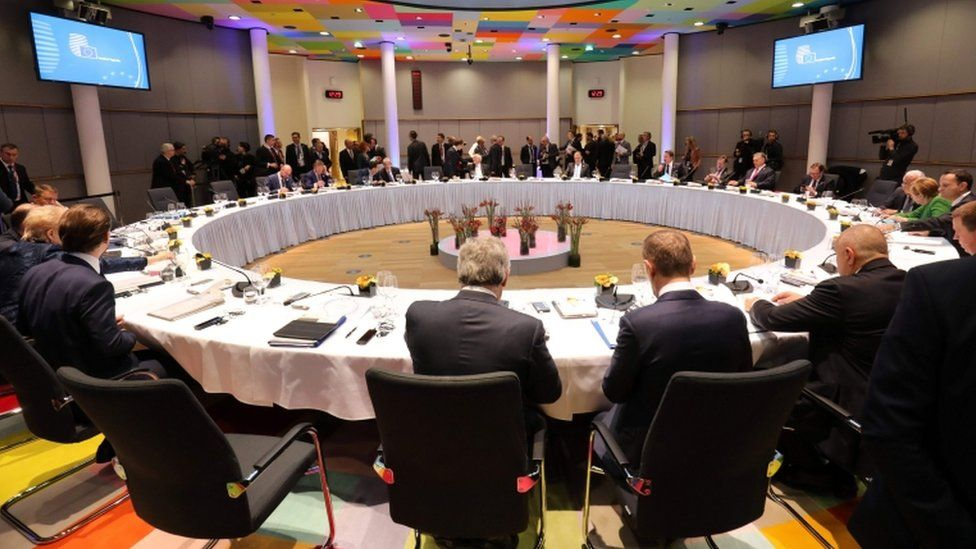 Officials attend a lunch during an informal meeting of the 27 EU heads of state or government in Brussels, sitting around circular table
