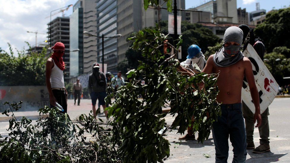 Demonstrators block a street at a rally against Venezuelan President Nicolas Maduro's government in Caracas, August 8, 201