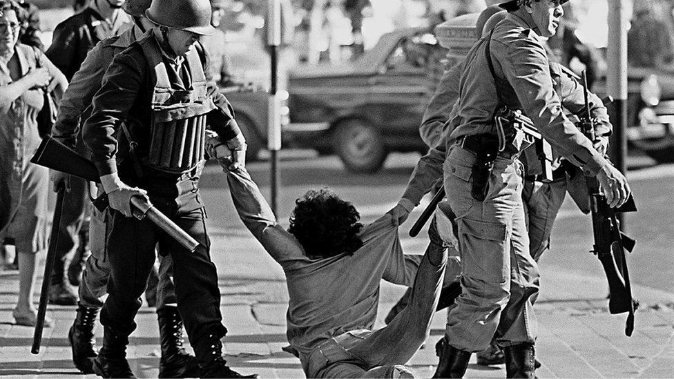 Worker being arrested during a protest against Argentine dictatorship in Buenos Aires. 30 March 1982