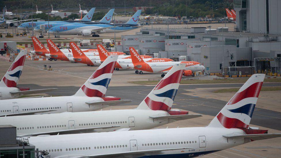 BA, Easyjet and TUI planes on the runway