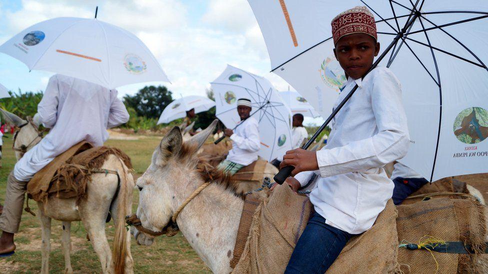 Participants riding donkeys
