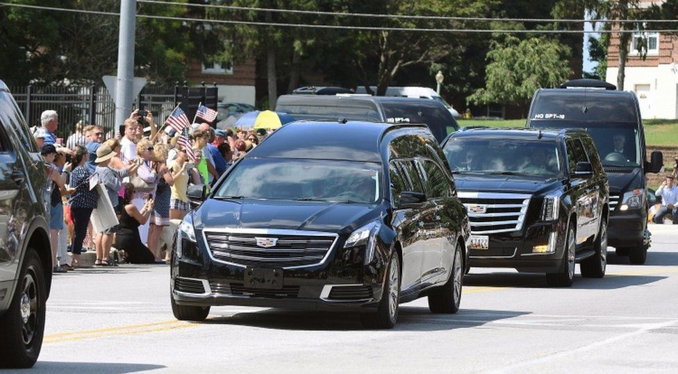 A hearse containing the body of Senator John McCain arrives for his burial