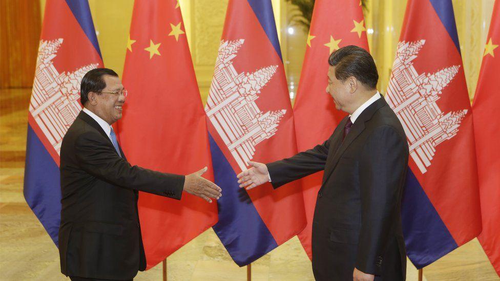 Cambodian PM Hun Sen greets Chinese president Xi Jinping