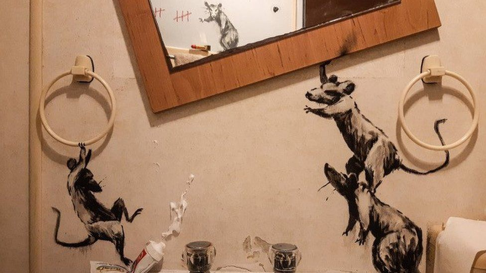 Bansky's latest artwork showing a group of rats in his bathroom