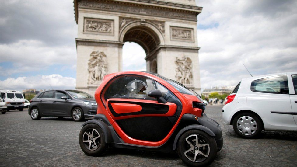 An electric car from Renault drives past the Arc de Triomphe in Paris on 30 May 2017