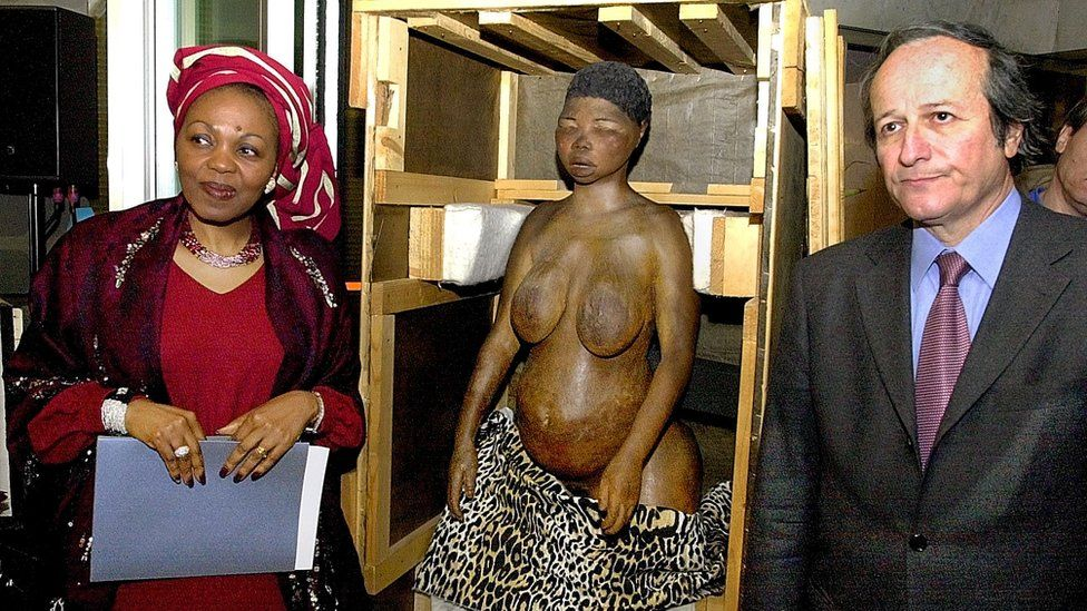 South African Ambassador to France Thuthukile Edy Skweyiya, left, and French Research Minister Roger Gerard Schwartzenberg pose next to a plaster cast of Saartjie Baartman, during a ceremony to mark the return of Baartman's remains at the South African embassy in Paris Monday April 29, 2002.