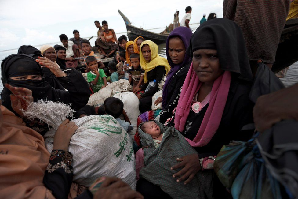 Newly arrived Rohingya refugees board a boat as they transfer to a camp in Cox's Bazar, Bangladesh, 2 October 2017.