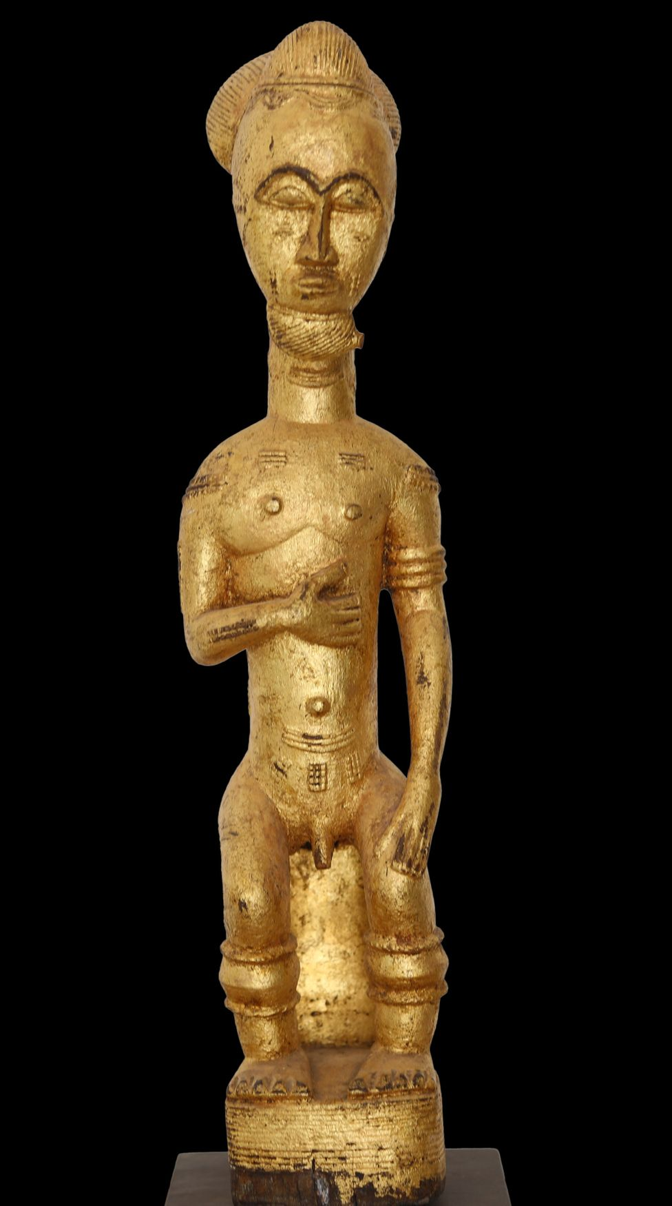 A gilded statue depicting a male figure