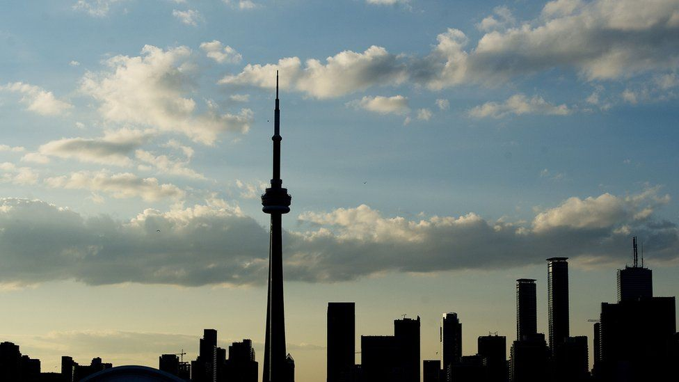 A silhouetted view of the skyline in Toronto, Ontario, on July 10, 2015