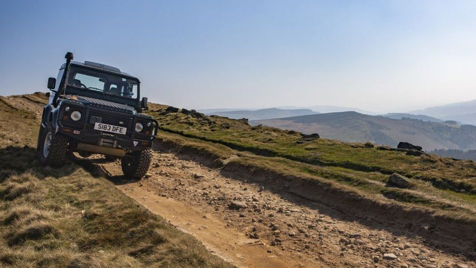 Landrover Defender on Stanage Edge