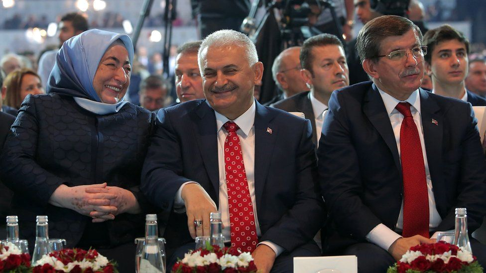 Ahmet Davutoglu (right) sits alongside Mr Yildirim and his wife at the congress in Ankara, 22 May