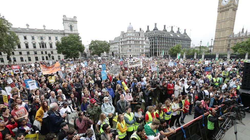 Protesters hold a 'Refugees Welcome' march in Parliament Square