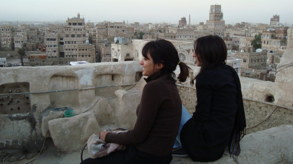 Mai (left) and her sister look out across the Sanaa skyline in 2009