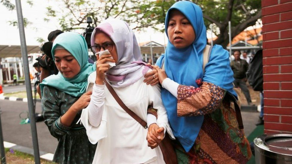Relatives of passengers of Lion Air flight JT610 that crashed into the sea, arrive at crisis centre at Soekarno Hatta International airport near Jakarta, Indonesia, October 29, 2018.