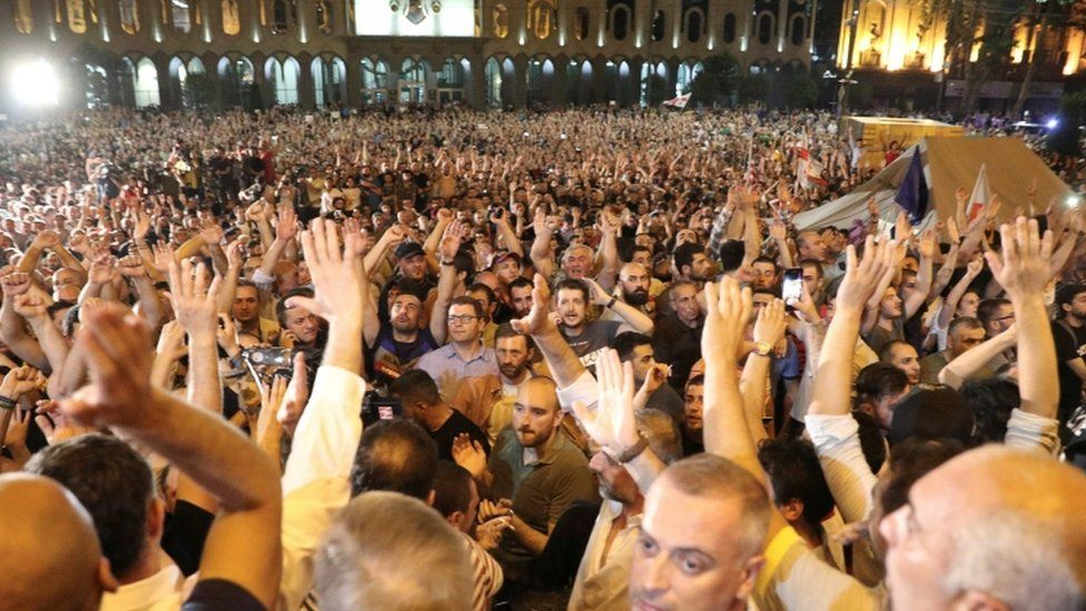 An anti-government rally outside parliament in Tbilisi, Georgia