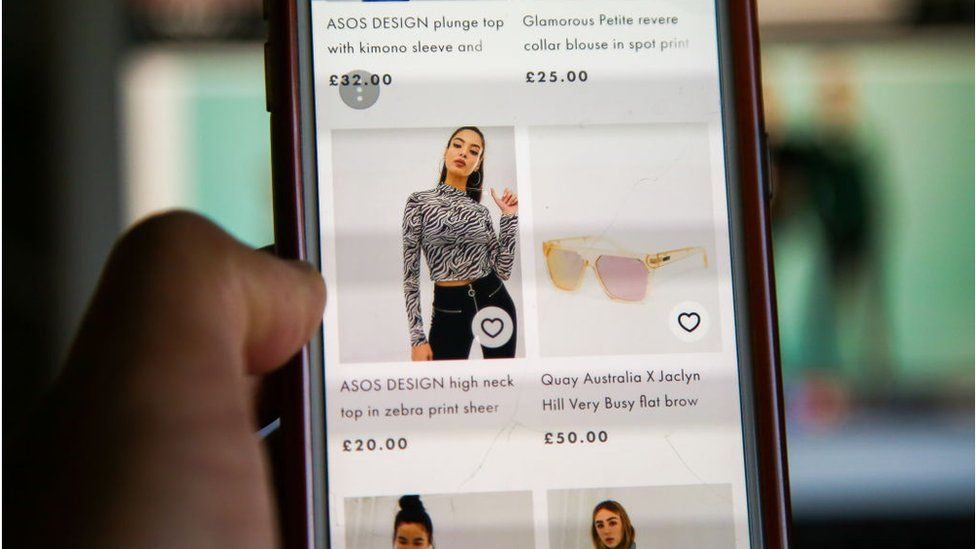 A woman scrolling on the Asos website on mobile