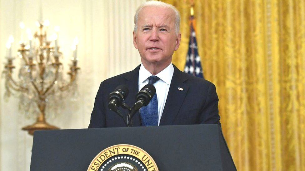 US President Joe Biden answers questions about the fuel pipeline cyber-attack during a speech about the economy at the White House
