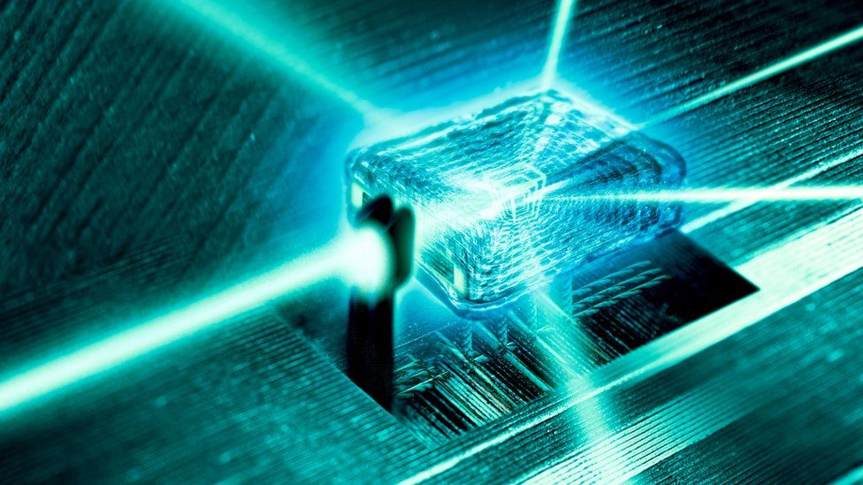 Light rays passing through the nanoscale crystal core of a quantum computer.