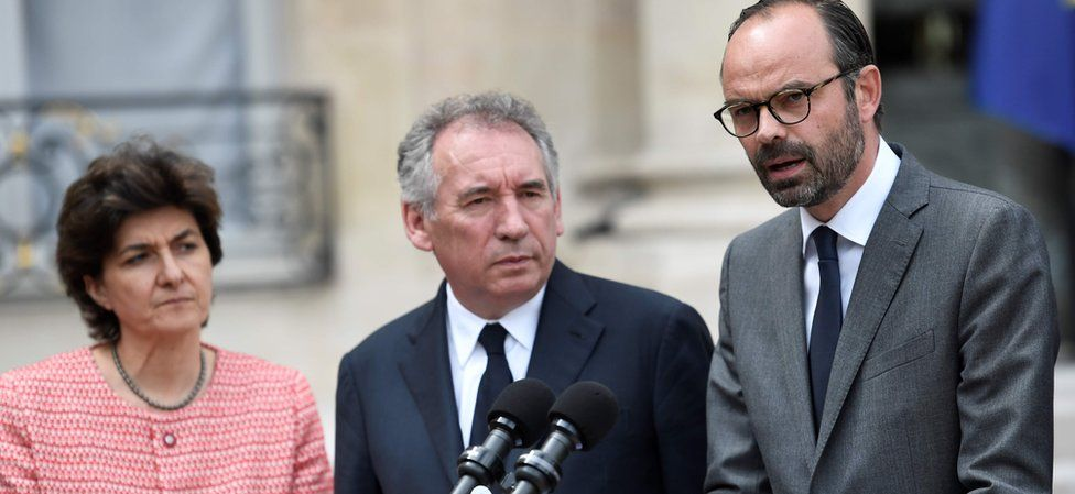 French Prime Minister Edouard Philippe (R) speaks flanked by French Minister of the Armed Forces Sylvie Goulard (L) and French Minister of Justice François Bayrou after the weekly cabinet meeting on May 24, 2017