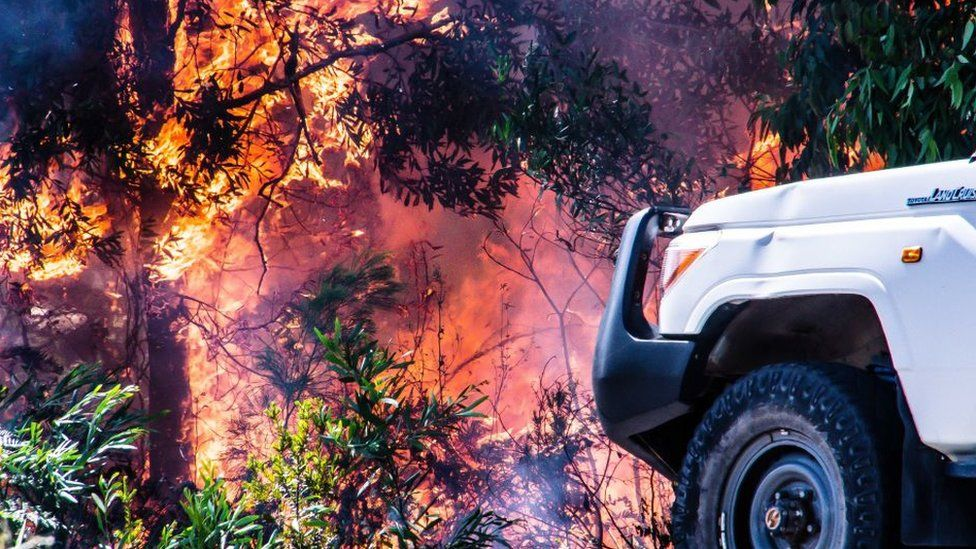 Burning wildfire with vehicle