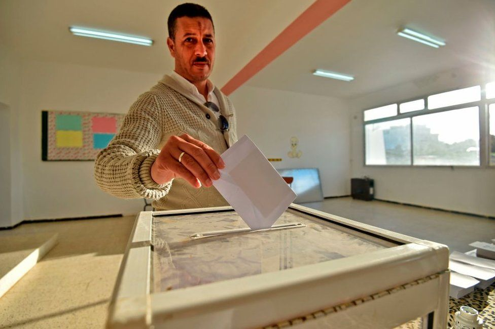 An Algerian man casts his vote on 12 December in Algiers.