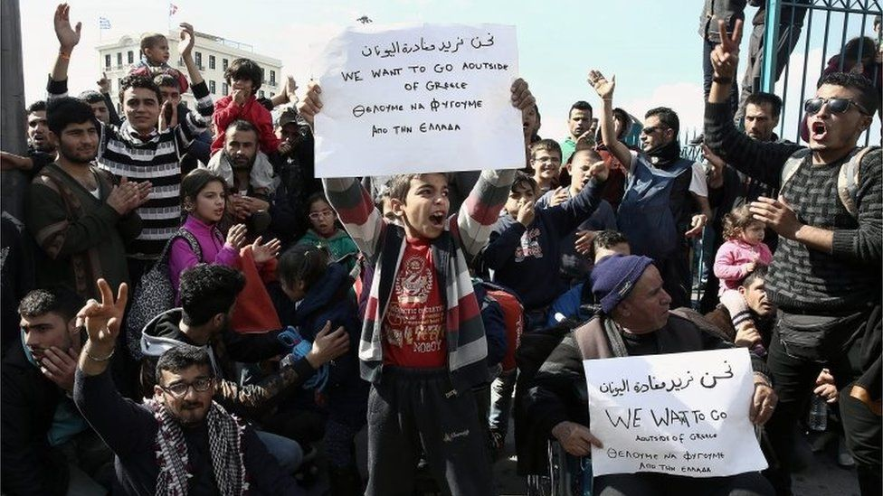 Syrian refugees shout slogans during a protest march in the port of Piraeus in Athens, Greece, 26 February 2016, demanding the opening of the borders.