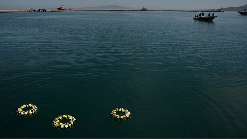 Wreathes thrown by Pope Francis into the sea